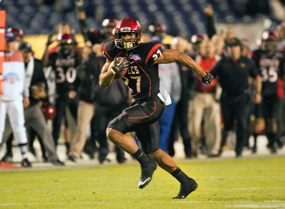. Eric Pinkins #27 of the San Diego State Aztecs runs with the ball in the first half of the game against the BYU Cougars in the Poinsettia Bowl at Qualcomm Stadium on December 20, 2012 in San Diego, California. (Photo by Kent C. Horner/Getty Images)