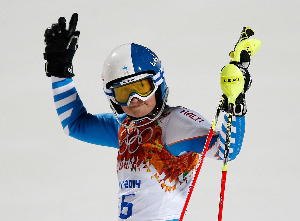 . Finland\'s Tanja Poutiainen gestures after finishing the second run of the women\'s slalom at the Sochi 2014 Winter Olympics, Friday, Feb. 21, 2014, in Krasnaya Polyana, Russia. (AP Photo/Christophe Ena)