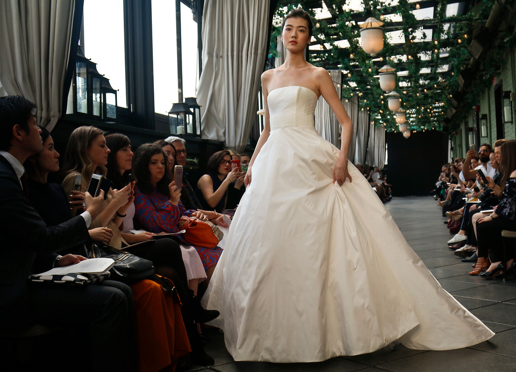. Bridal fashion from the Amsale collection is modeled during Bridal Fashion Week, Friday, April 13, 2018, in New York. (AP Photo/Bebeto Matthews)