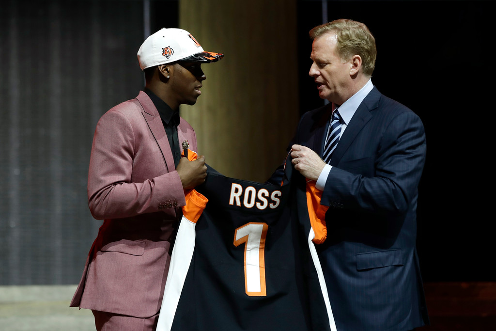 . Washington\'s John Ross, left, greets NFL commissioner Roger Goodell after being selected by the Cincinnati Bengals during the first round of the 2017 NFL football draft, Thursday, April 27, 2017, in Philadelphia. (AP Photo/Matt Rourke)