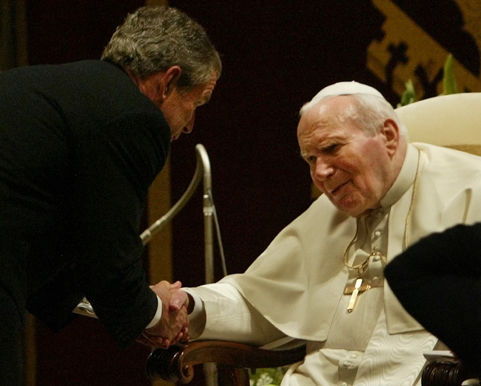 . President Bush shakes the hand of Pope John Paul II after making their joint statements at the Vatican Friday, June 4, 2004. (AP Photo/Charles Dharapak)