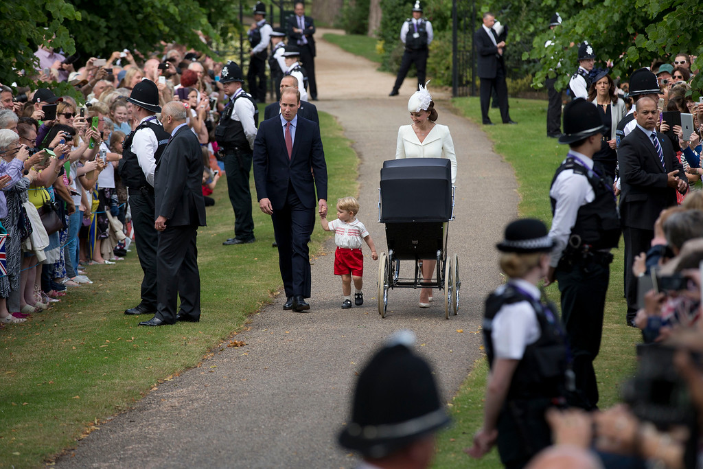 . Catherine, Duchess of Cambridge, Prince William, Duke of Cambridge, Princess Charlotte of Cambridge and Prince George of Cambridge arrive at the Church of St Mary Magdalene on the Sandringham Estate for the Christening of Princess Charlotte of Cambridge on July 5, 2015 in King\'s Lynn, England.  (Photo by Matt Dunham - WPA Pool/Getty Images)