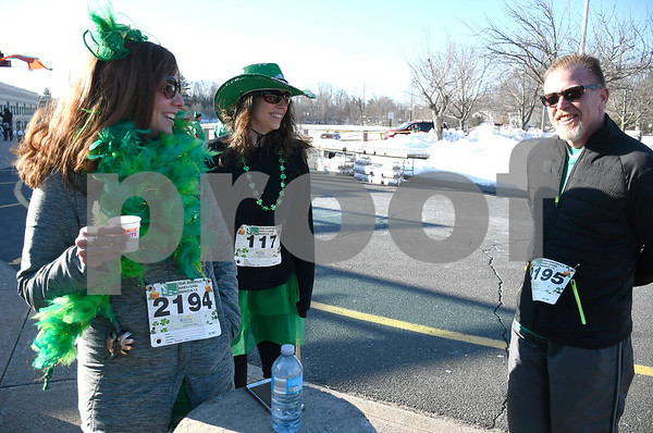 3/17/2018 Mike Orazzi | Staff Darcie LeBlanc, Kelli Kozaryn and Steve LeBlanc during the 16th Annual Shamrock Run and Walk held at the Chippens Hill Middle School Saturday morning.