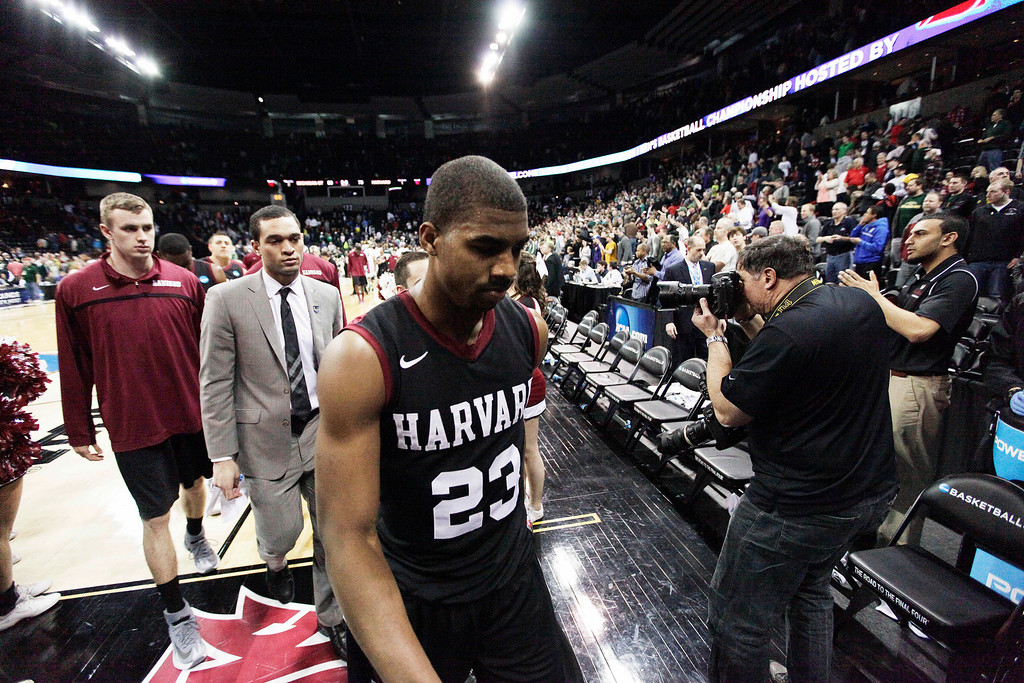 . Harvardís Wesley Saunders (23) walks off the court after the third-round game of the NCAA men\'s college basketball tournament against Michigan State in Spokane, Wash., Saturday, March 22, 2014. Michigan State won 80-73. (AP Photo/Young Kwak)