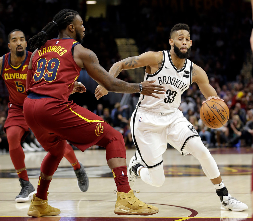 . Brooklyn Nets\' Allen Crabbe (33) drives against Cleveland Cavaliers\' Jae Crowder (99) in the first half of an NBA basketball game, Wednesday, Nov. 22, 2017, in Cleveland. (AP Photo/Tony Dejak)