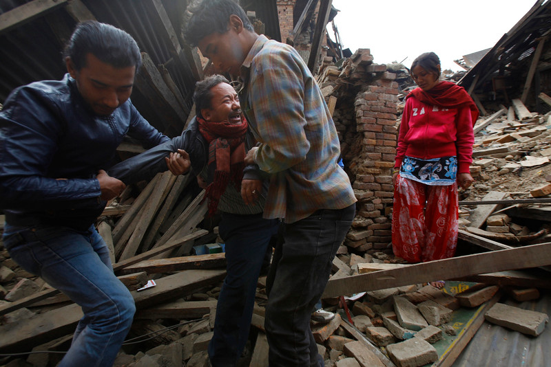 . A Nepalese man cries after rescue workers found his mothers body amid earthquake debris in Bhaktapur near Kathmandu, Nepal, Sunday, April 26, 2015. A strong magnitude-7.9 earthquake shook Nepal\'s capital and the densely populated Kathmandu Valley before noon Saturday, causing extensive damage with toppled walls and collapsed buildings, officials said. (AP Photo/Niranjan Shrestha)