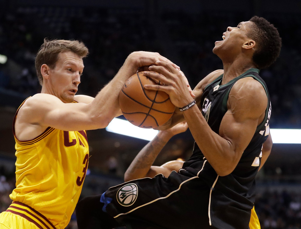 . Milwaukee Bucks\' Giannis Antetokounmpo is fouled by Cleveland Cavaliers\' Mike Dunleavy during the second half of an NBA basketball game Tuesday, Dec. 20, 2016, in Milwaukee. The Cavaliers won 114-108. (AP Photo/Morry Gash)