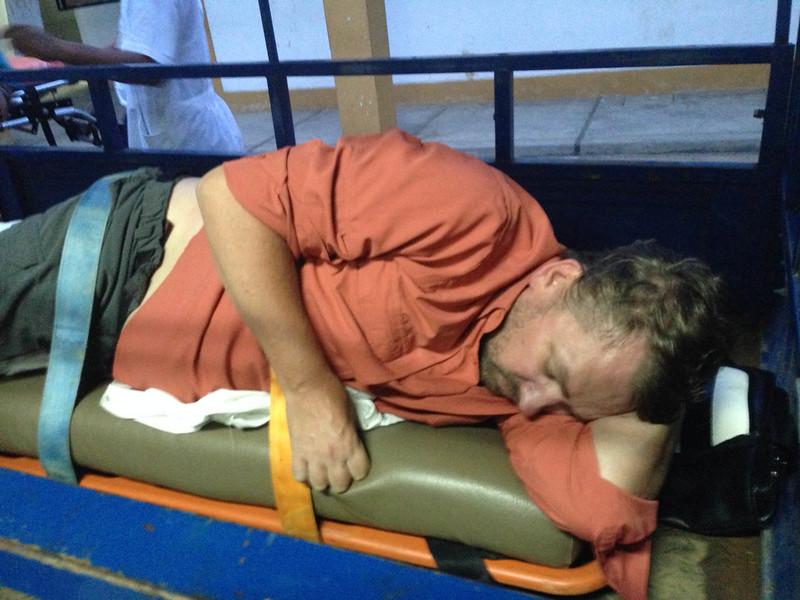 Dave on makeshift stretcher.jpg