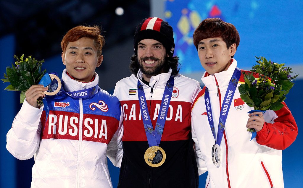 . Men\'s 1,500-meter short track speedskating medalists, from left, Russia\'s Viktor Ahn, bronze, Canada\'s Charles Hamelin, gold, and China\'s Han Tianyu, silver, pose with their medals at the 2014 Winter Olympics in Sochi, Russia, Monday, Feb. 10, 2014. (AP Photo/Morry Gash)