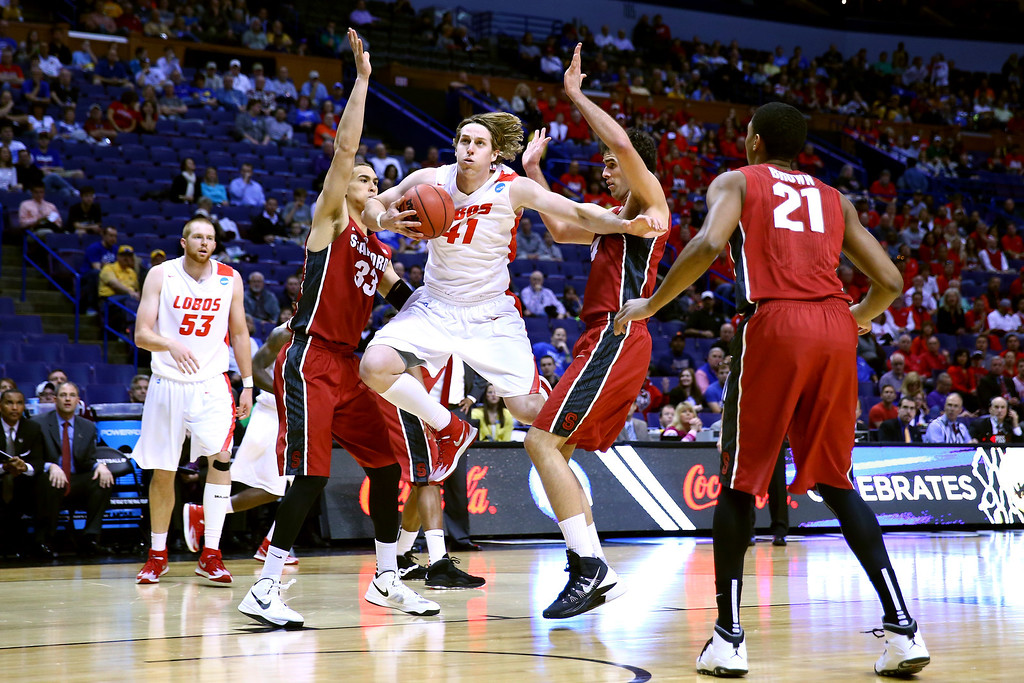 . Cameron Bairstow #41 of the New Mexico Lobos fights for the ball in the first half against the Stanford Cardinal during the second round of the 2014 NCAA Men\'s Basketball Tournament at Scottrade Center on March 21, 2014 in St Louis, Missouri.  (Photo by Dilip Vishwanat/Getty Images)