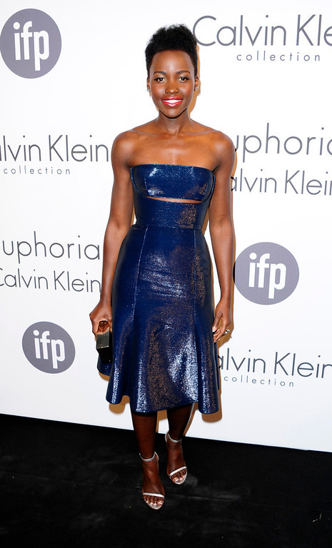 . In this photo taken Thursday, May 15, 2014, Lupita Nyong\'o poses for photographers as she arrives for the Women In Film Party at the 67th international film festival, Cannes, southern France, Thursday, May 15, 2014. (Photo by Arthur Mola/Invision/AP)