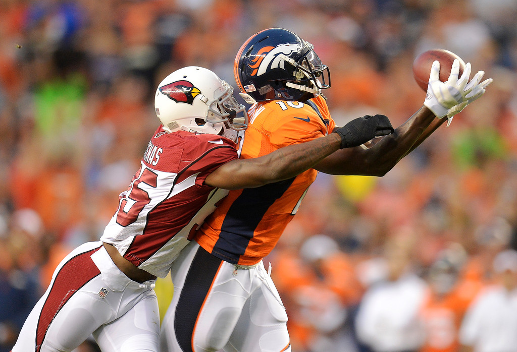 . Denver Broncos wide receiver Gerell Robinson (10) hauls in a catch as Arizona Cardinals cornerback Javier Arenas (35) defends during the first half on August 29, 2013 at Sports Authority Field at Mile High. The Denver Broncos hosted the Arizona Cardinals in the final game of the preseason. (Photo by John Leyba/The Denver Post)