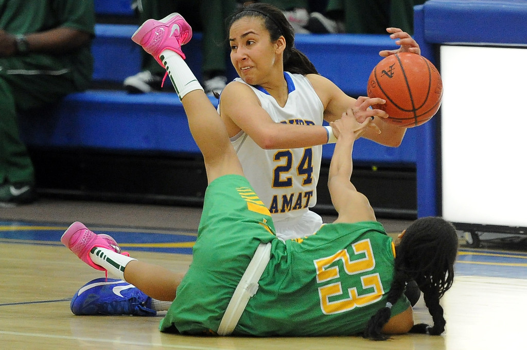 . Bishop Amat\'s Jennifer Vasquez (24) scrambles for the loose ball with Long Beach Poly\'s Arica Carter (23) in the second half of a CIF State Southern California Regional semifinal basketball game at Bishop Amat High School on Tuesday, March 12, 2013 in La Puente, Calif. Long Beach Poly won 52-34.  (Keith Birmingham Pasadena Star-News)