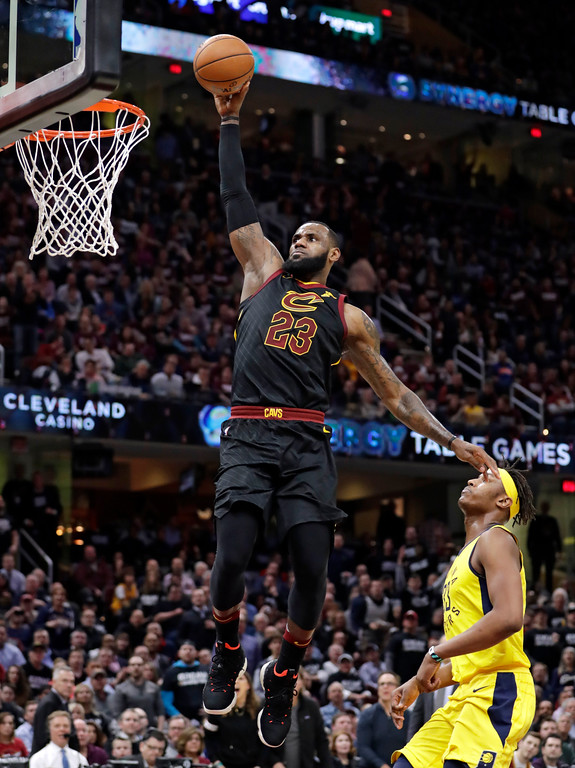 . Cleveland Cavaliers\' LeBron James (23) drives to the basket against Indiana Pacers\' Myles Turner (33) during the first half of Game 2 of an NBA basketball first-round playoff series Wednesday, April 18, 2018, in Cleveland. (AP Photo/Tony Dejak)