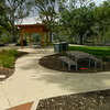 picnic table and benches and bbq with timber post and rail shade structure