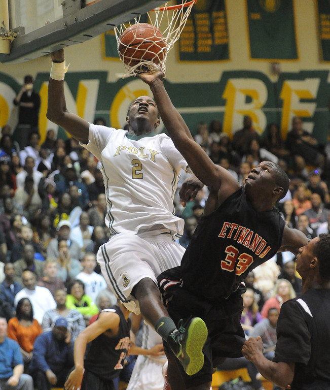 . 02-26-2012--(LANG Staff Photo by Sean Hiller)-Etiwanda beat Long Beach Poly 59-55 in Tuesday\'s CIF Southern Section Division 1AA semifinal boys basketball game at Long Beach Poly High School. Jordan Bell battles Tim Myles.