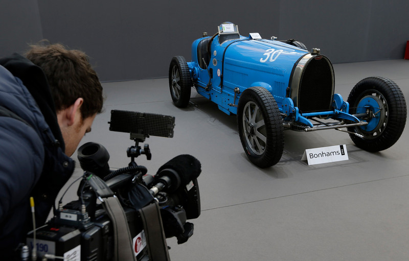 . A cameraman films a Bugatti Type 54 (1931) motor car which is displayed during an exhibition of vintage cars and motorcycles at the Grand Palais exhibition hall as part of the Retromobile vintage car show in Paris February 6, 2013. This exceptional collection of motor cars and motorcycles will go on sale at a Bonhams\' auction on February 7.   REUTERS/Philippe Wojazer