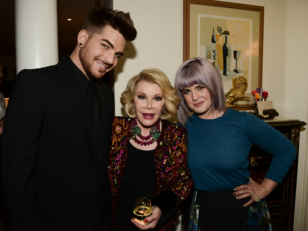 ". Singer Adam Lambert, left, comedian Joan Rivers, center, and television personality Kelly Osbourne at the ""Glamorous By George\"" book launch hosted by Joan and Melissa Rivers on Monday, Jan. 13, 2014 in Los Angeles. (Photo by Dan Steinberg/Invision/AP)"