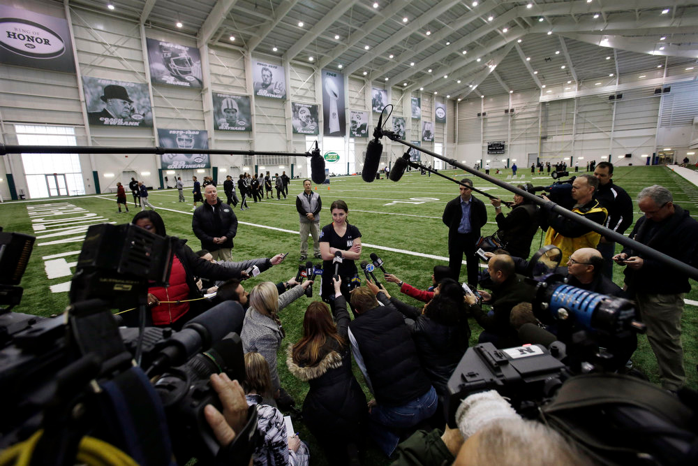 . Lauren Silberman addresses reporters after taking two attempts during kicker tryouts at an NFL football regional combine workout, Sunday, March 3, 2013, at the New York Jets\' training facility in Florham Park, N.J. (AP Photo/Mel Evans)