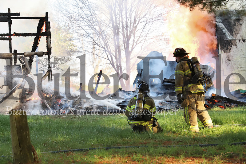 Firefighters respond to structure fire on Little Creek Road Tuesday evening. Seb Foltz/Butler Eagle