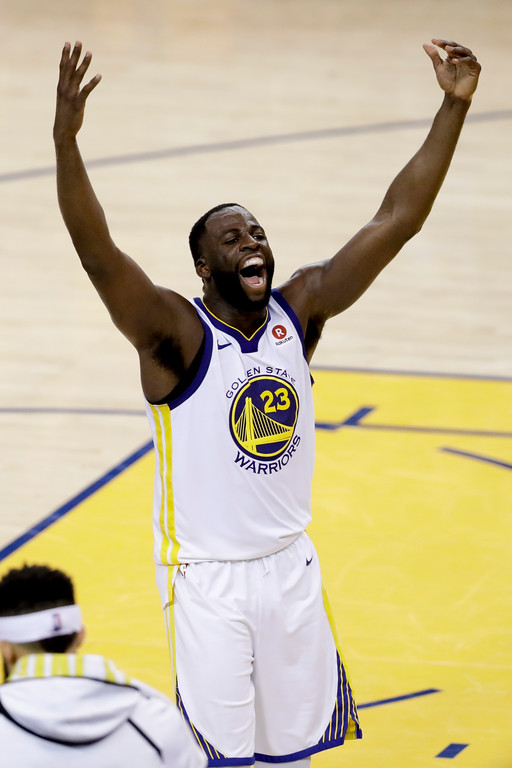. Golden State Warriors forward Draymond Green, celebrates during overtime of Game 1 of basketball\'s NBA Finals against the Cleveland Cavaliers in Oakland, Calif., Thursday, May 31, 2018. The Warriors won 124-114. (AP Photo/Marcio Jose Sanchez)