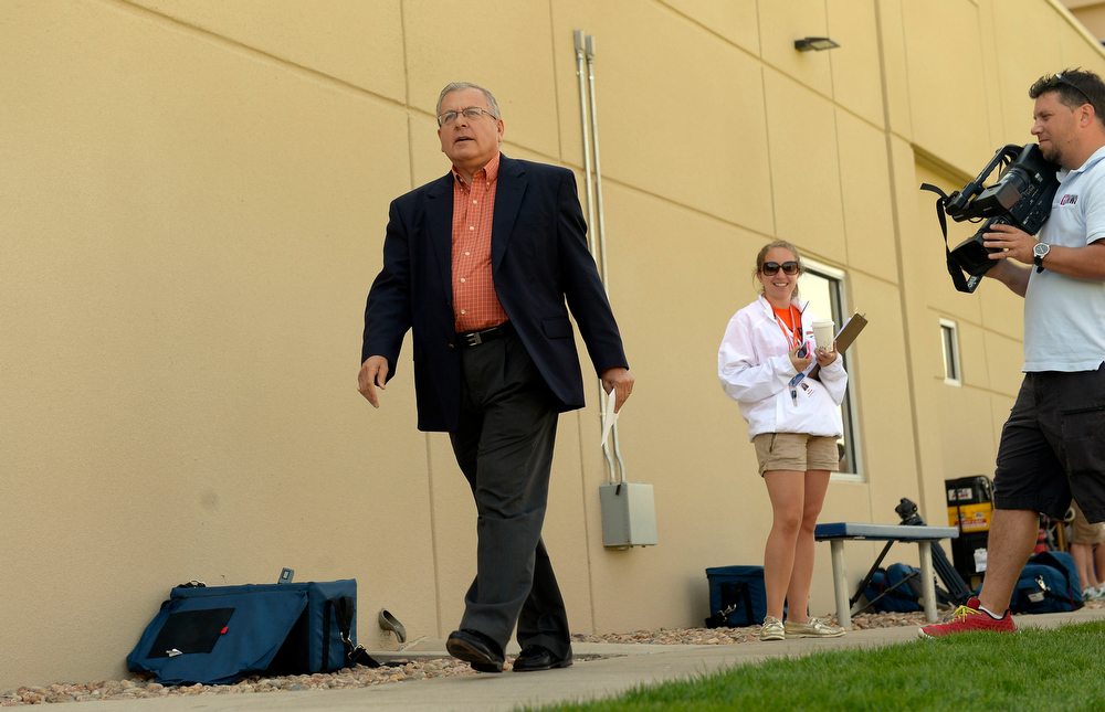 . Denver Broncos Vice President of Corporate Communications Jim Saccomano has announced that he will retire at the conclusion of the 2013 season. Jim walks out to the field during training camp July 26, 2013 at Dove Valley. (Photo By John Leyba/The Denver Post)