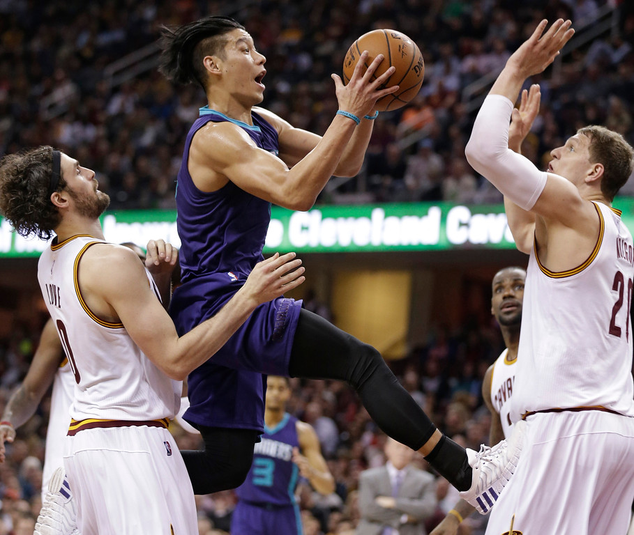 . Charlotte Hornets\' Jeremy Lin, center, drives to the basket against Cleveland Cavaliers\' Kevin Love, left, and Timofey Mozgov in the first half of an NBA basketball game Wednesday, Feb. 24, 2016, in Cleveland. (AP Photo/Tony Dejak)