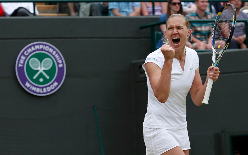 . Kaia Kanepi of Estonia celebrates after defeating Laura Robson of Britain in their women\'s singles tennis match at the Wimbledon Tennis Championships, in London July 1, 2013.      REUTERS/Suzanne Plunkett