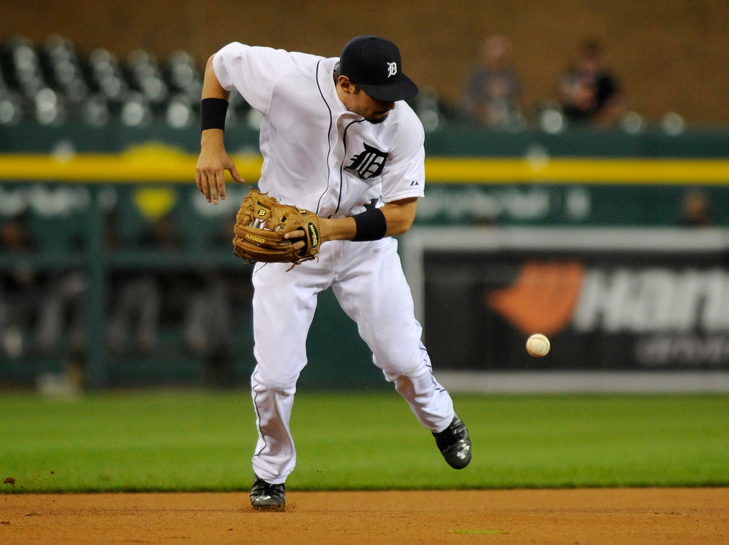 . Detroit Tigers\' Nick Castellanos bobbles a grounder from San Francisco Giants� Hunter Pence, who was safe at first on Castellanos\' error in the fourth inning of a baseball game Friday, Sept. 5, 2014, in Detroit. (AP Photo/Jose Juarez)