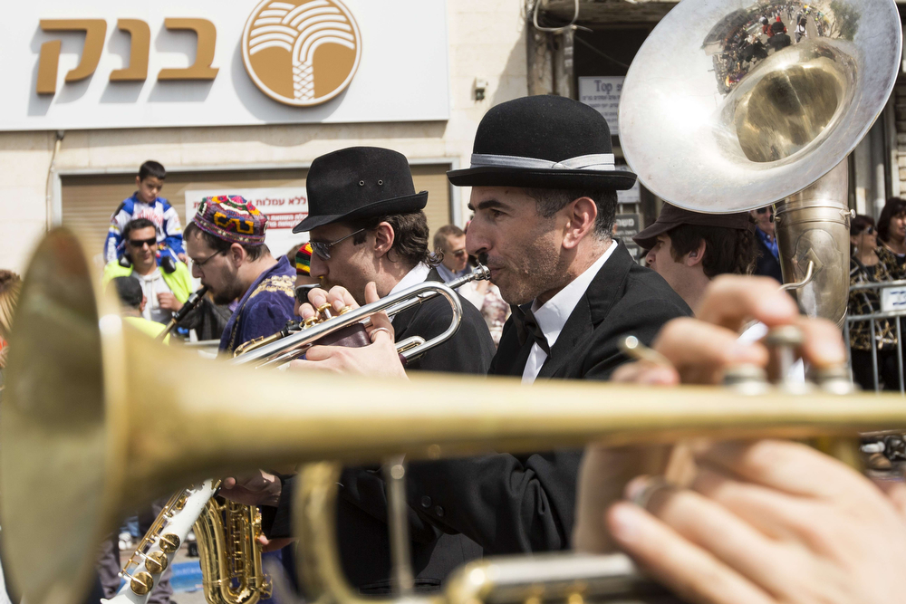 . Israeli musicians take part in a parade to celebrate the Jewish holiday of Purim on March 16, 2014 in the central Israeli city of Netanya. The carnival-like Purim holiday is celebrated with parades and costume parties to commemorate the deliverance of the Jewish people from a plot to exterminate them in the ancient Persian empire 2,500 years ago, as recorded in the Biblical Book of Esther. (JACK GUEZ/AFP/Getty Images)
