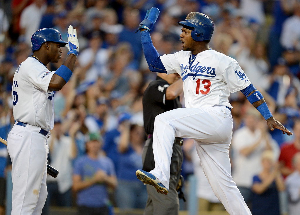 . Los Angeles Dodgers\' Yasiel Puig celebrates as Hanley Ramirez brings in a run during game 3 of the NLDS at Dodger Stadium Sunday, October 6, 2013. (Photo by Hans Gutknecht/Los Angeles Daily News)