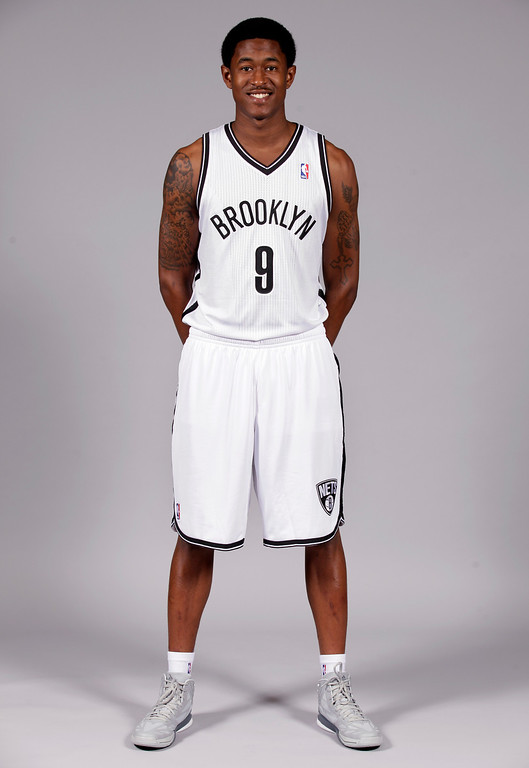 . MarShon Brooks poses for photos during Brooklyn Nets basketball media day, in the Brooklyn borough of New York, Monday, Oct. 1, 2012. (AP Photo/Richard Drew)
