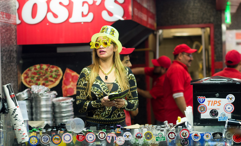 . NEW YORK, NY - DECEMBER 31: Vendors sell beer at Rosa\'s Pizza in the LIRR section of Penn Station as revelers celebrate New Year\'s Eve on December 31, 2014 in New York City. An estimated one million people from around the world are expected to pack Times Square to ring in 2015. (Photo by Andrew Theodorakis/Getty Images).