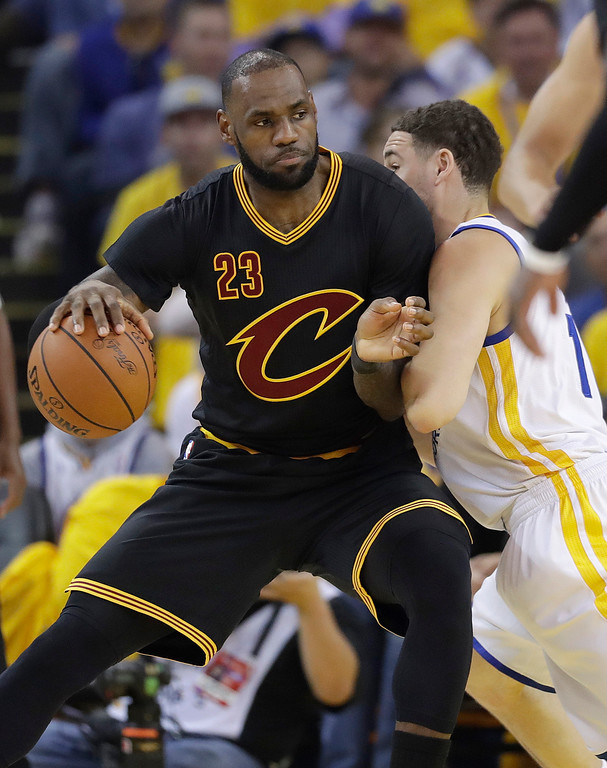 . Cleveland Cavaliers forward LeBron James (23) dribbles against Golden State Warriors guard Klay Thompson during the first half of Game 5 of basketball\'s NBA Finals in Oakland, Calif., Monday, June 12, 2017. (AP Photo/Marcio Jose Sanchez)