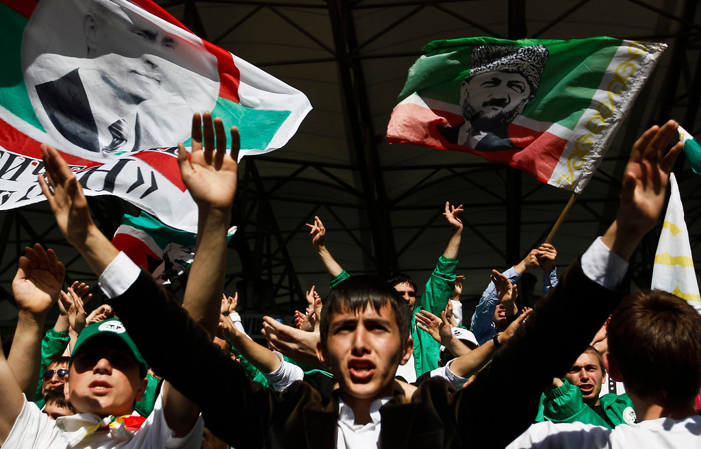 . Terek Grozny fans support their team during a soccer match against Amkar Perm at the Akhmad Arena stadium in the Chechen capital Grozny April 27, 2013. The naming of two Chechens, Dzhokhar and Tamerlan Tsarnaev, as suspects in the Boston Marathon bombings has put Chechnya - the former site of a bloody separatist insurgency - back on the world\'s front pages. Chechnya appears almost miraculously reborn. The streets have been rebuilt. Walls riddled with bullet holes are long gone. New high rise buildings soar into the sky. Spotless playgrounds are packed with children. A giant marble mosque glimmers in the night. Yet, scratch the surface and the miracle is less impressive than it seems. Behind closed doors, people speak of a warped and oppressive place, run by a Kremlin-imposed leader through fear.   Picture taken April 27, 2013.   REUTERS/Maxim Shemetov