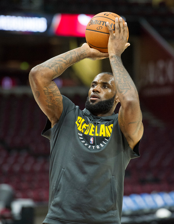 . Cleveland Cavaliers\' LeBron James warms up before playing an NBA pre-season basketball game against the Chicago Bulls in Cleveland, Tuesday, Oct. 10, 2017. (AP Photo/Phil Long)