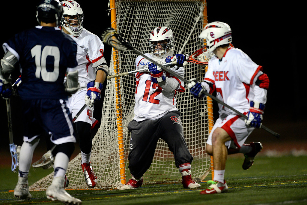 . Columbine\'s Jake Gonzales scores on Cherry Creek\'s Addison Christensen during Cherry Creek\'s 7-6 win.  (Photo by AAron Ontiveroz/The Denver Post)