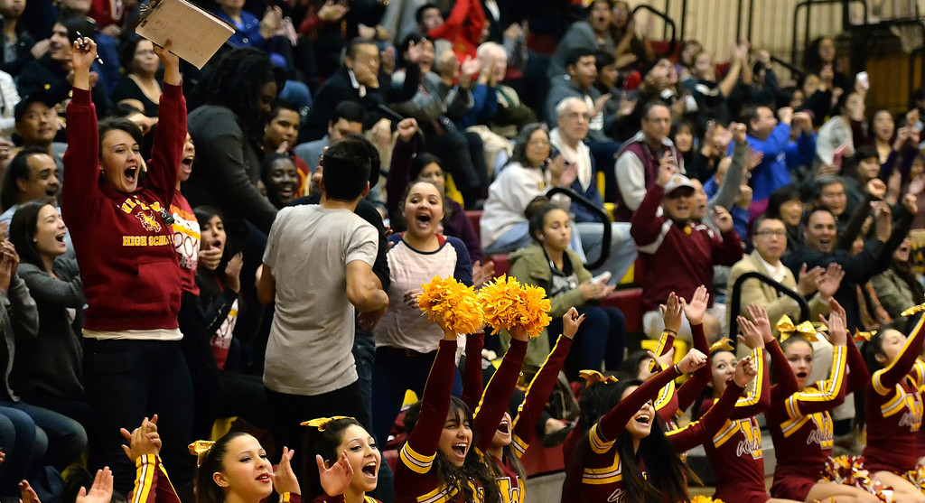 . Wilson fans react after a three pointer in the first half of a prep basketball game against San Dimas at Wilson High School in Hacienda Heights, Calif., on Friday, Jan. 31, 2014. (Keith Birmingham Pasadena Star-News)