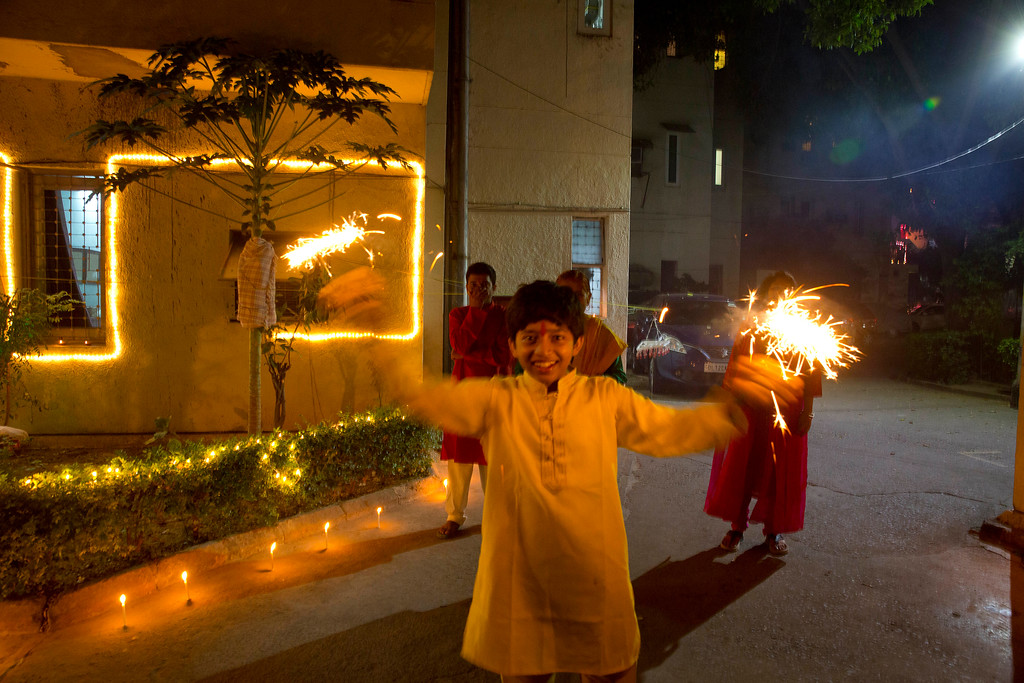 . An Indian boy plays with firecrackers during Diwali festival in New Delhi, India, Thursday, Oct. 19, 2017. Worried especially by the impact on the health of children, the Supreme Court this year banned the sale of firecrackers, that is usually in huge demand across the country as the evening sky is lit up by the festivities, in the Indian capital and neighboring areas to prevent a toxic haze after the Diwali nights that has residents hiding indoors. (AP Photo/Manish Swarup)