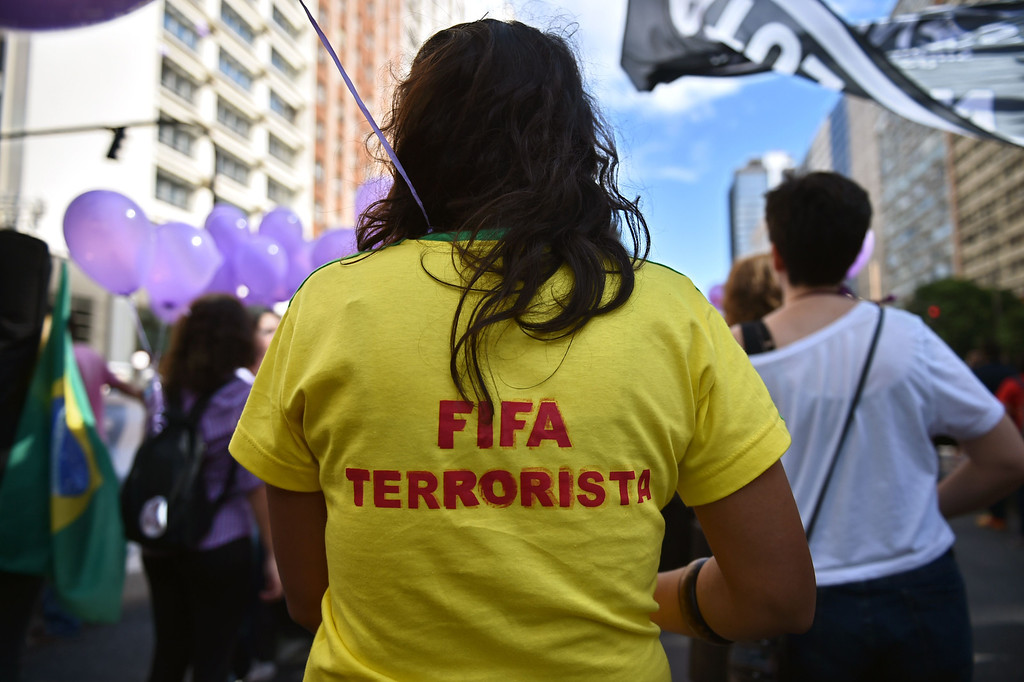 . A demonstrator takes part in an anti-World Cup protest in Rio de Janeiro on June 12, 2014. AFP PHOTO / YASUYOSHI CHIBA/AFP/Getty Images