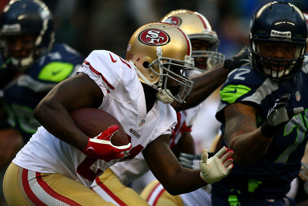 . Frank Gore #21 of the San Francisco 49ers runs the ball against the Seattle Seahawks during their game at Qwest Field on September 15, 2013 in Seattle, Washington.  (Photo by Jonathan Ferrey/Getty Images)