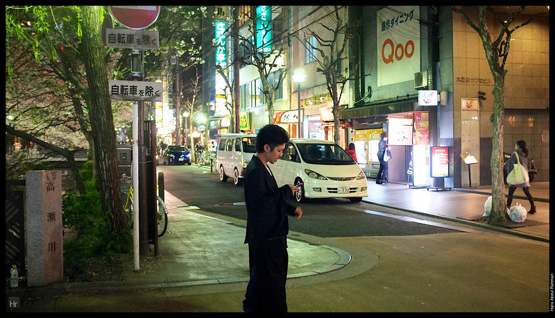 Looking for customers for the restaurants.  Walking by Gion 4th April 2013 Kyoto