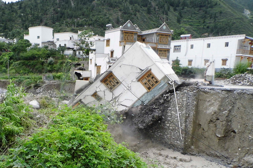 . A house is seen damaged after a landslide in Aba Tibetan and Qiang Autonomous Prefecture, Sichuan Province, July 11, 2013. China braced on Friday for the impact of Typhoon Soulik as the toll of dead and missing from torrential rain across a broad swathe of China climbed beyond 200. Picture taken July 11, 2013. REUTERS/Stringer