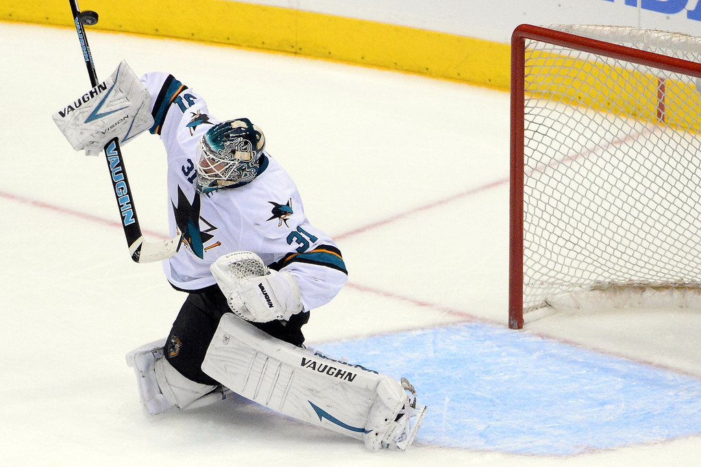 . San Jose Sharks goalie Antti Niemi deflects a shot on goal by the Los Angeles Kings during the second period in Game 4 of an NHL hockey first-round playoff series at Staples Center in Los Angeles on Thursday, April, 24  2014.  (Keith Birmingham Pasadena Star-News)