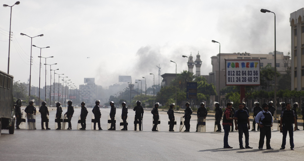 . Egyptian security forces cordon off an area near Cairo\'s Rabaa al-Adawiya mosque after a police crackdown on a protest camp by supporters of ousted president Mohamed Morsi and members of the Muslim Brotherhood on August 14, 2013. Security forces moved in on two huge Cairo protest camps set up by supporters of Egypt\'s ousted president Mohamed Morsi, launching a crackdown that quickly turned into a bloodbath with dozens dead.  MAHMOUD KHALED/AFP/Getty Images