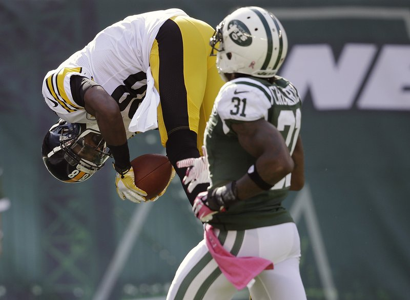 . <p><b> Ravens at Steelers (-2):</b>  <p>Pittsburgh coach Mike Tomlin has banned end zone somersaults, calling such high-flying antics �silly.� So the Steelers� offense will have to come up with new ways to celebrate its weekly touchdown. <p>Pick: <b>Ravens by 3</b> <p>     (AP Photo/Seth Wenig)