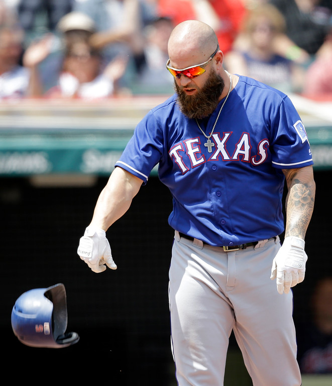 . Texas Rangers\' Mike Napoli throws his helmet after striking out against Cleveland Indians starting pitcher Corey Kluber in the second inning of a baseball game, Thursday, June 29, 2017, in Cleveland. (AP Photo/Tony Dejak)