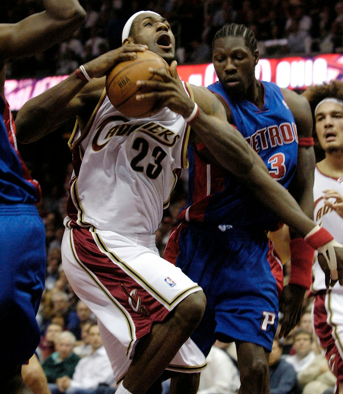 . Michael Blair/MBlair@News-Herald.com The Cavs LeBron James goes in for a basket between Piston defenders Antonio McDyess and Ben Wallace during the first half of Monday\'s game.