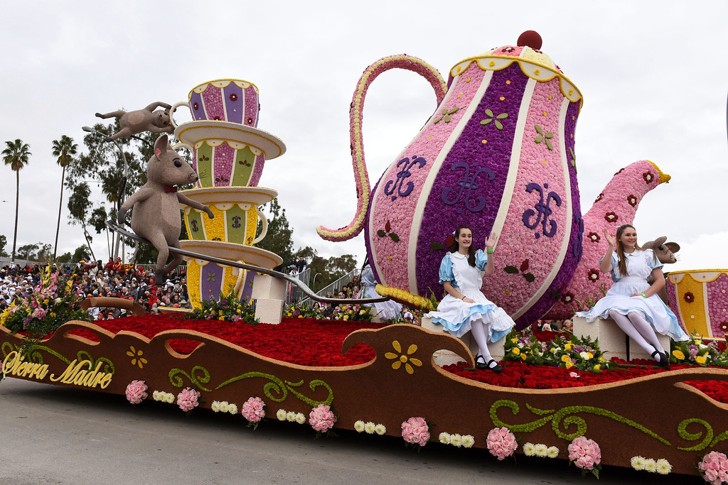 . The Sierra Madre Rose Float Association float The Cat\'s Away, winner of the Mayors\' Trophy for most outstanding city entry - national or international rolls along the 128th Rose Parade in Pasadena, Calif., Monday, Jan. 2, 2017. (AP Photo/Michael Owen Baker)