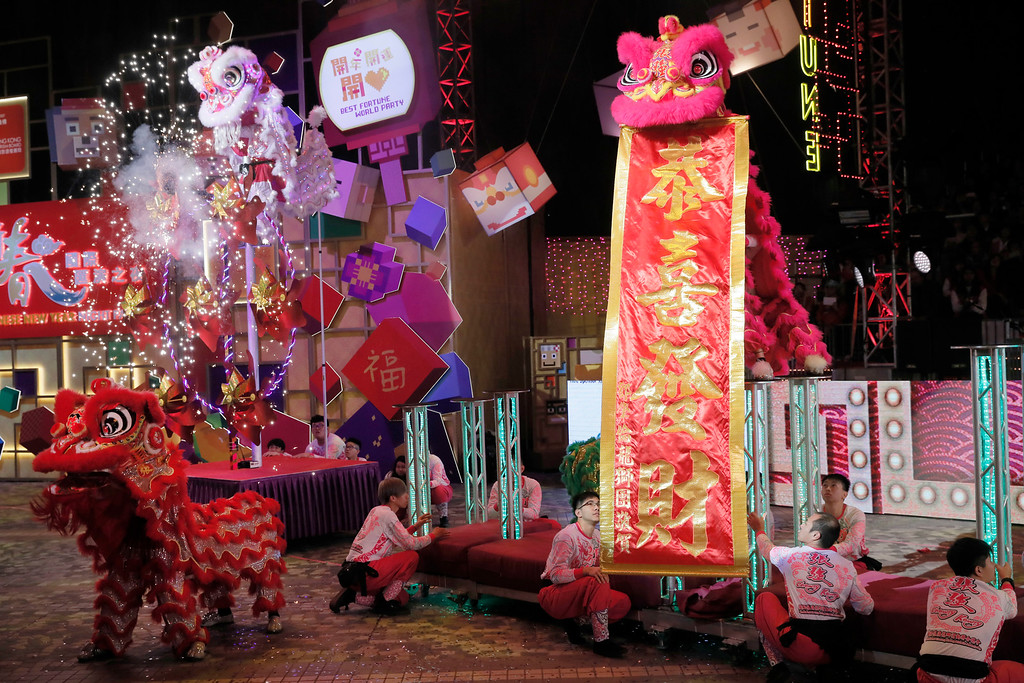 . Lion dance take part take part in a night parade to celebrate Chinese New Year in Hong Kong Friday, Feb. 16, 2018. The Lunar New Year this year marks the Year of the Dog in the Chinese calendar. (AP Photo/Vincent Yu)